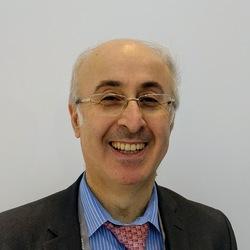 A dermatologist, Dr Bassam Zeina, smiling at the camera